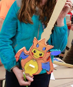 Photo of student displaying her ukulele