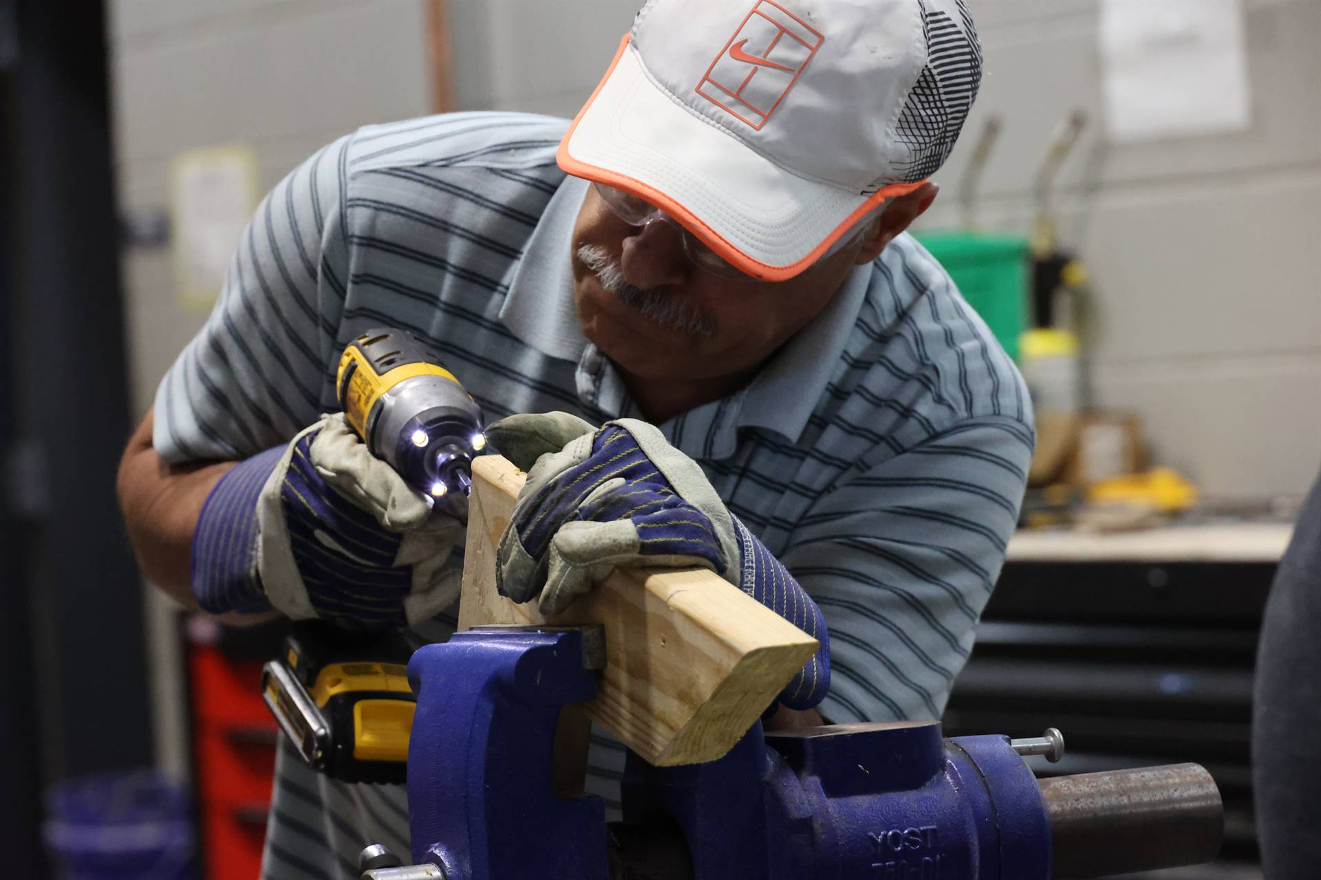 Man using power drill to create wood structure